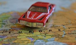 Toy car on top of a print map.