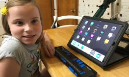 Girl smiling with Focus 40 and iPad