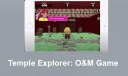 "Screenshot of Temple Explorer with character standing at a crossroad inside the temple. Text, ""Temple Explorer: O&M Game"""