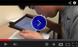 A visually impaired student is taking screenshots of his geometry assignment with an app called EduCreations.