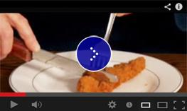 Image illustration of how to cut chicken cutlet with a fork and knife.