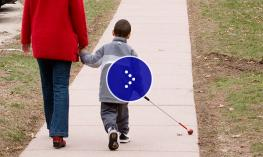 Image of a student walks with a cane.