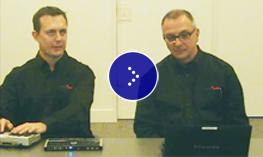 Dominic Gagliano and Greg Stilson from Humanware demonstrates Humanware's Deaf-Blind communicator.
