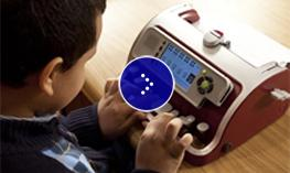 A child with Perkins Smart Brailler.