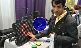 Visually impaired participant at a technology conference.