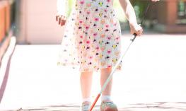 Child with a cane.