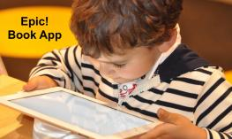 """Young boy holding and looking intently at an iPad with text, """"Epic! Book App"""""""