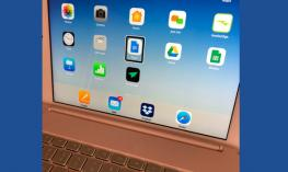 Photo of an iPad and Bluetooth keyboard with the VoiceOver blackbox cursor on the Docs icon.