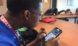 Kahmile using the NatSci museum app with VoiceOver.