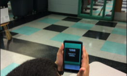 Student in classroom using an iOS magnification app.
