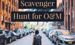 """Image of a girl walking down the middle of a city street with the text, """"Scavenger Hunt for O&M"""