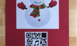 Snowman picture with QR code mounted below.