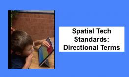 "4 year old tapping top of the iPad screen and text, ""Spatial Tech Standards: Directional Terms"""