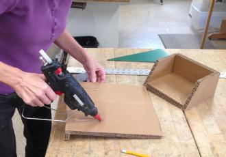 Image of a person making cardboard.