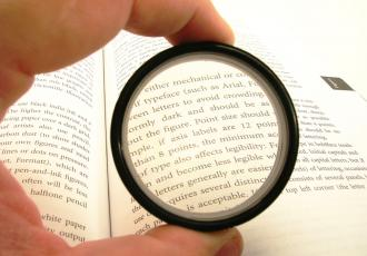 Image of a magnifying glass zoom to a text.