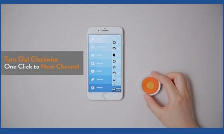 """fingers rotating 06 beside an iPhone; text, """"Turn dial clockwise. One click to next channel."""""""