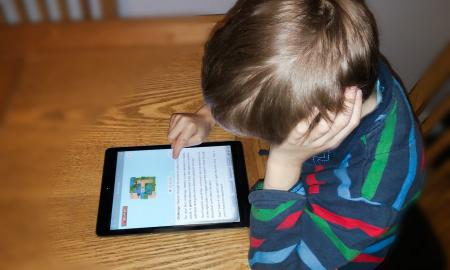 A boy on an iPad
