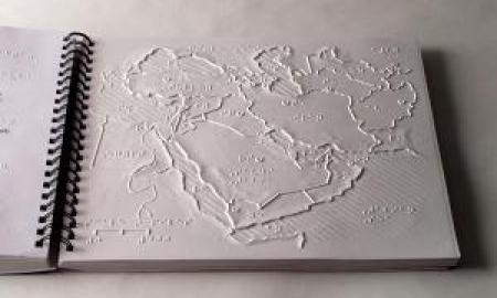 The image is of the APH Tactile World Maps.