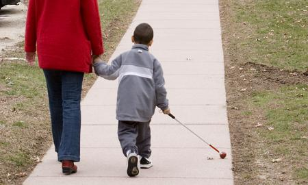 Young student walks with a cane