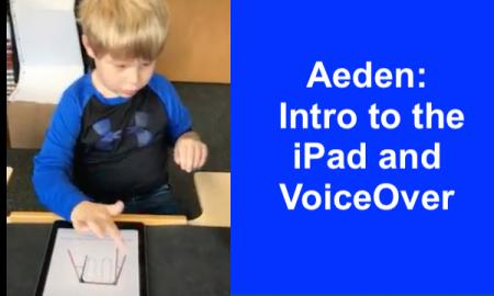 Photo of 6 year old Aeden tapping the iPad to turn the page in his  Pictello book.