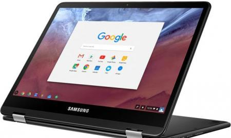 Chromebook flipped into a tablet orientation with keyboard resting face down on desk