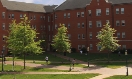 Image of college dorms opening to a quad with sidewalks.