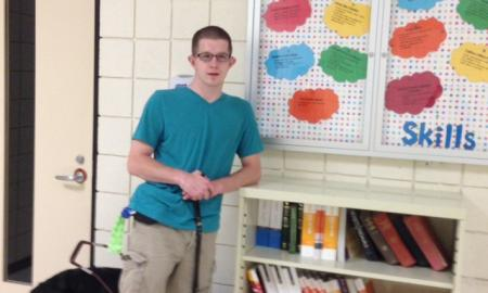 Hunter in front of Study Skills bulletin board