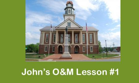 "Image of Pittsboro's Historic courthouse with text, "" John's O&M Lesson #1"""
