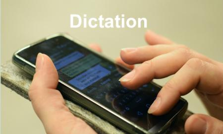 Photo of a woman' hands using Dictation to text on a smart phone.