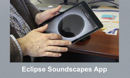 Photo of a man holding an iPad with the Rumble Map feature of the Eclipse Soundscapes app.