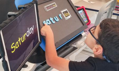 """student builds the word """"Saturday"""" with magnetic letters"""