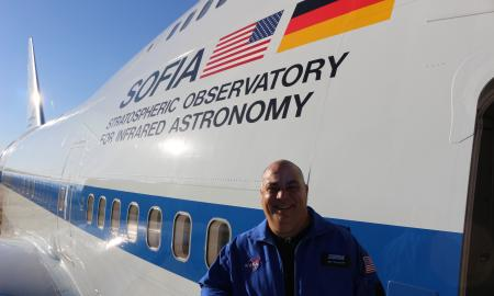 Mr. Killebrew standing in front of the SOFIA aircraft.