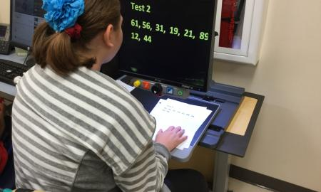 Student studies the numbers with music for trial 2.
