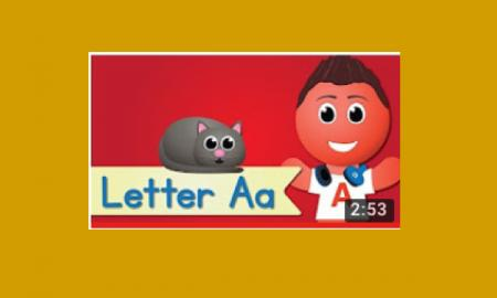 "Screen shot of the Letter A song video with a boy beside a curled up cat and text, ""Letter A"""