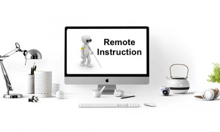 """Black and white image of a computer at home with screen displaying a cartoon person using a cane and text,"""" Remote Instruction"""""""
