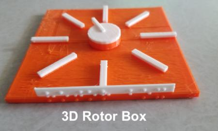 "photo of 3D printed virtual rotor with orange base and white spinnable dial with text, ""3D rotor box""."