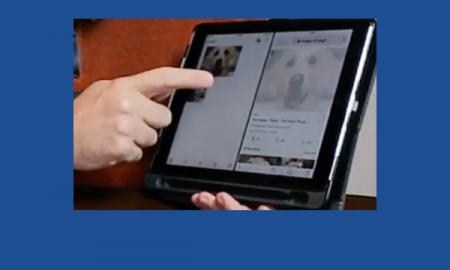Hand pointing to an iPad which is displaying the Split View.