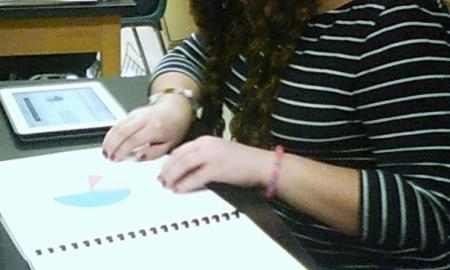 Student using braille to read