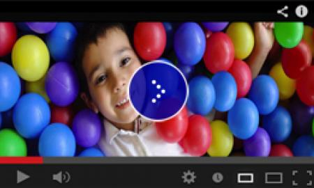 Image of a boy in a colorful ball pit.