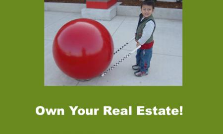 "Smiling 4 year old with precane bumped up to Red Cement Ball at Target. Text, ""Own your Real Estate!"""