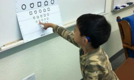 Image of a little boy pointing at Lea symbols.