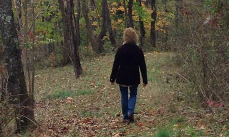 A woman walking in the woods