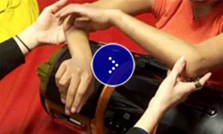 A demonstration of hand over hand technique.