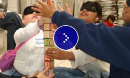 A group of blindfold students learning about deafblindness.