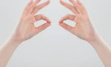 Photo of hands with index fingers touching thumbs.