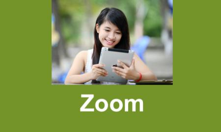 "Smiling teen holding an iPad with text, ""Zoom"""