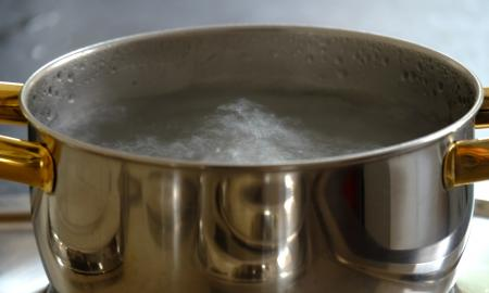 pan of boiling water on a stove