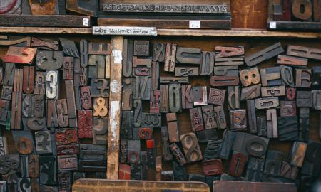 wooden letterpress letters in a drawer