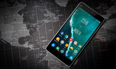 image of an Android phone on top of a world map.