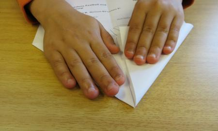 folding a paper airplane